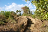 The path carved out of rock on the top of the island